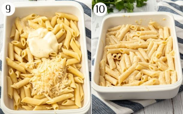 Pasta in a white casserole dish being mixed with cheese and bechamel