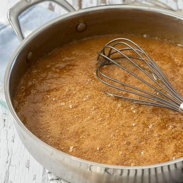 A pan of caramel sauce, bubbling