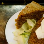 This Simple Pumpkin Zucchini Bread makes use of Pumpkin Stout for extra flavor, moisture and to replace the eggs. That makes this bread both Vegan & Dairy-Free! It is so sweet it could almost double as a cake | Suitcase Foodist