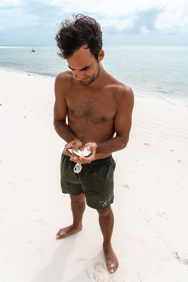 Eating fresh coconut at Onok Island - Balabac Palawan