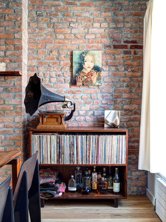 Gramophone atop a record collection