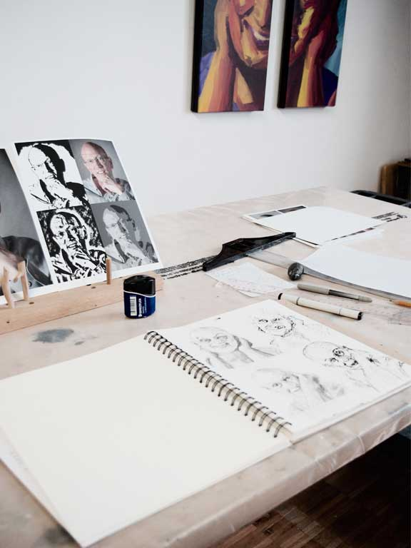 Sketches of current project on artist desk