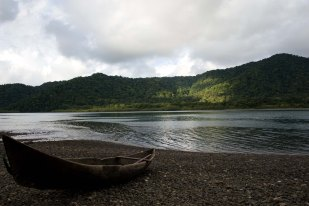 A canoe next to the river in Choco, Colombia