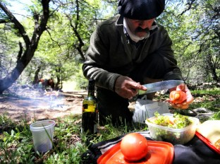 Anastacio prepares the lunch