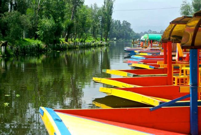 Lined up for business - trajineras in Xochimilco, Mexico