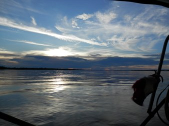 Enjoy a beautiful sunset on the boat tour on the Amazon in Colombia