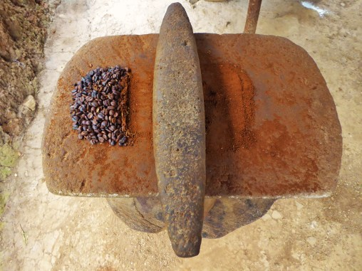 Traditional coffee grinding at Don Agustine's Finca, nothern Nicaragua