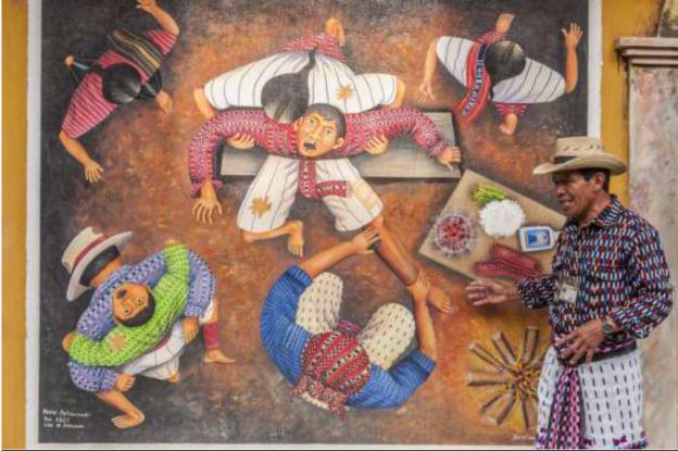 Our local guide explains Mayan culture through art in San Juan La Laguna, Guatemala