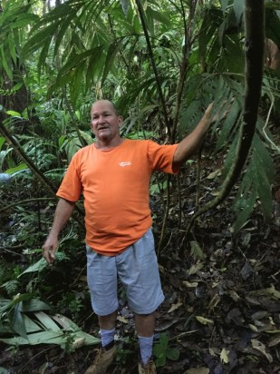 Our guide Carlos showing us the lush jungle which they have at Juanilama, Costa Rica