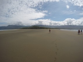 Walking along the iconic whale's tail formation at Marino Ballena National Park in Uvita, Costa Rica.
