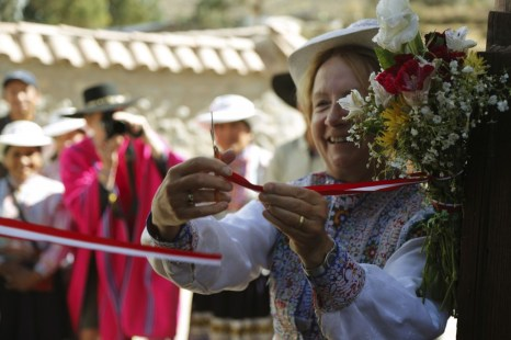A ribbon-cutting ceremony to inaugurate one of the homes rebuilt after the earthquake in Coporaque, Peru