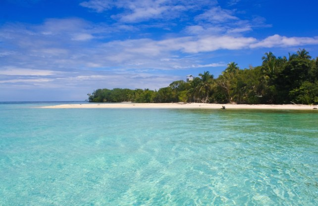 Crystal clear waters in the Caribbean, non touristy beaches of Belize