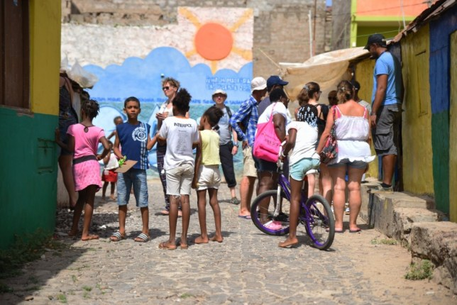 Interacting with the locals during a responsible urban community based tour in Brazil