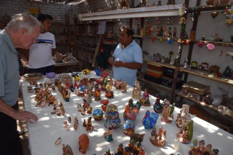 Juan (also from Ayacucho) showing the traditional ceramics he makes, most of them with religious or nativity motifs