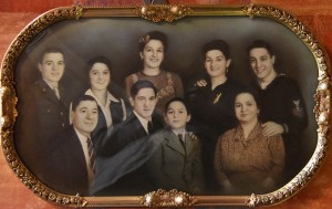 A family portrait of Frank Capo's parents and siblings hangs in the pizza shop in Geneva.