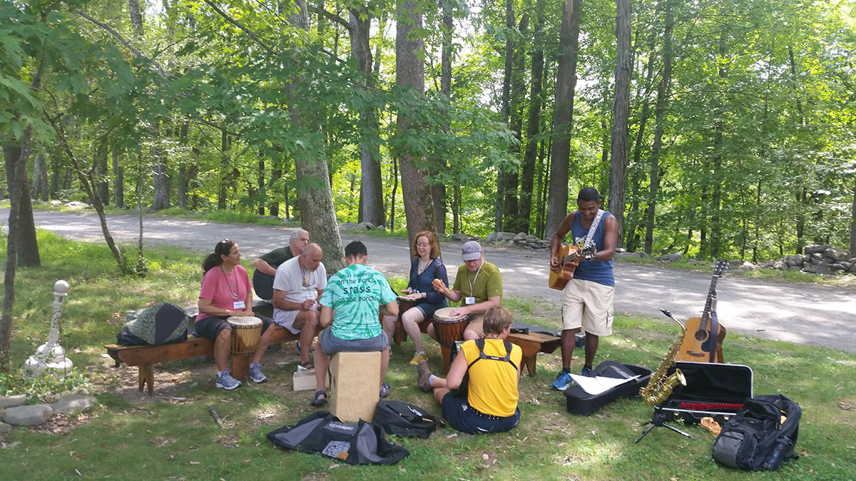 Write songs and perform together at SummerSongs songwriting camp