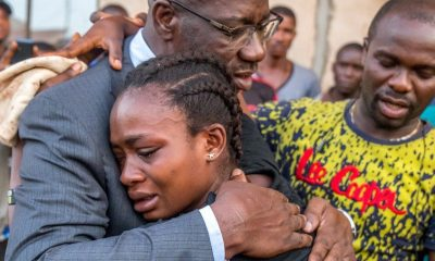 Edo State Governor, Mr. Godwin Obaseki consoling Ruth, wife of late David Okoniba, during the governor's visit to the families of the deceased in Urora community, Benin City, Edo State. Okoniba's death was allegedly caused by an exchange with a police officer in Benin City.