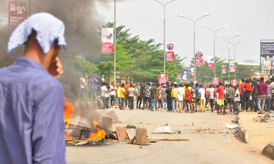 Scene of youths said to be members of the Edo State Chapter of the All Progressives Congress (APC) protesting the factionalisation of the APC in the state, in Benin City, on Thursday, December 12, 2019.