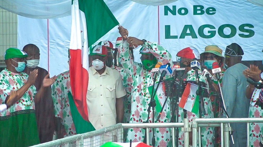 Obaseki and his deputy, Comrade Philip Shuaibu takes hold of the PDP Flag as the candidates of the party in the Sept. 19 election