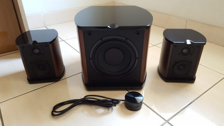 The primary units: 1 subwoofer, 2 satellite speakers, and the power/volume control unit.