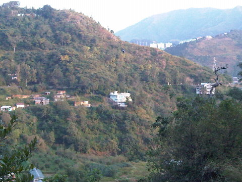 Our house with its land is called 'Whispering Wind,s Kandaghat'. In the background the HIMUDA and AFNHB colony can be seen.
