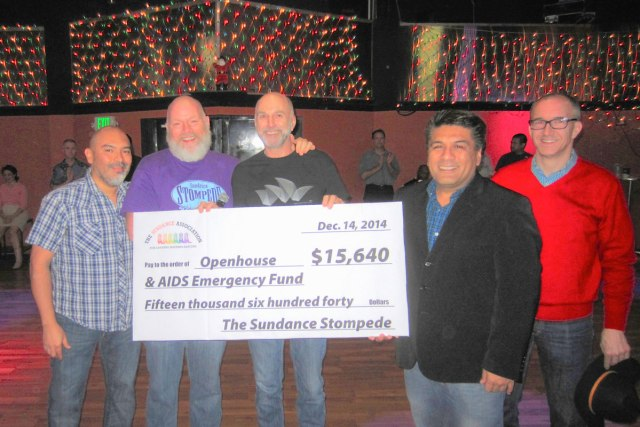 Holiday Ball: Stompede beneficiary check presentation