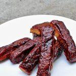 Sticky, smokey, vegan Bbq Seitan Ribs on plate.