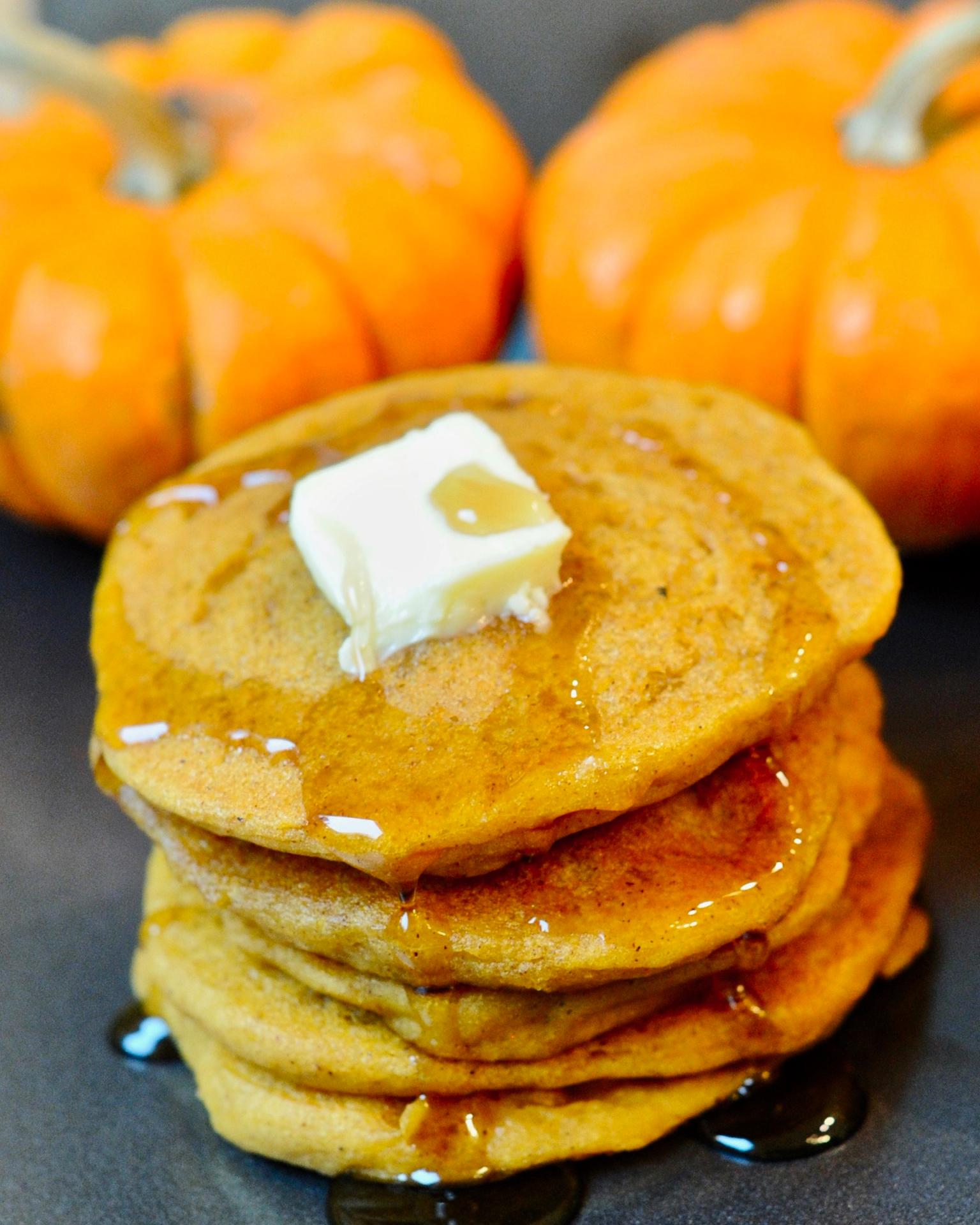 Maple syrup on a stack of pumpkin spice pancakes