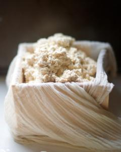 Cheesecloth draped box filled with tofu curds