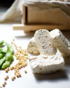 edamame, soybeans and tofu on white counter