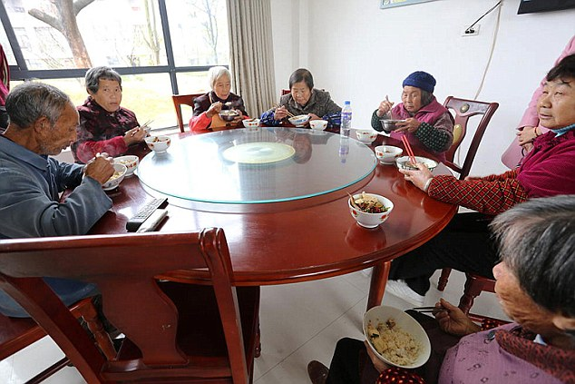 Chinese millionaire buys homes for poor
