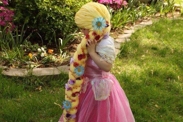 woman makes disney princess hair for girls with cancer
