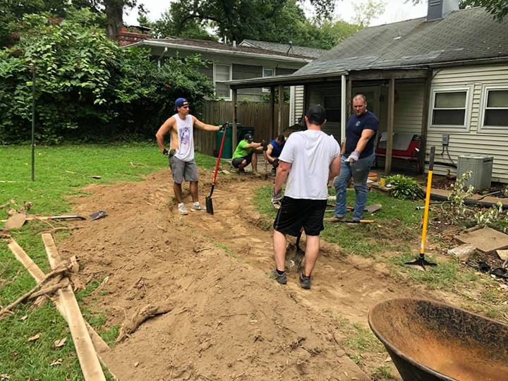 firefighters build path for