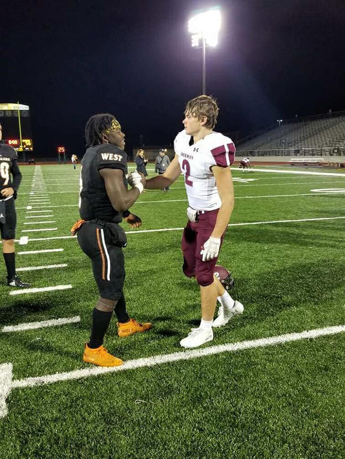 football players pray together
