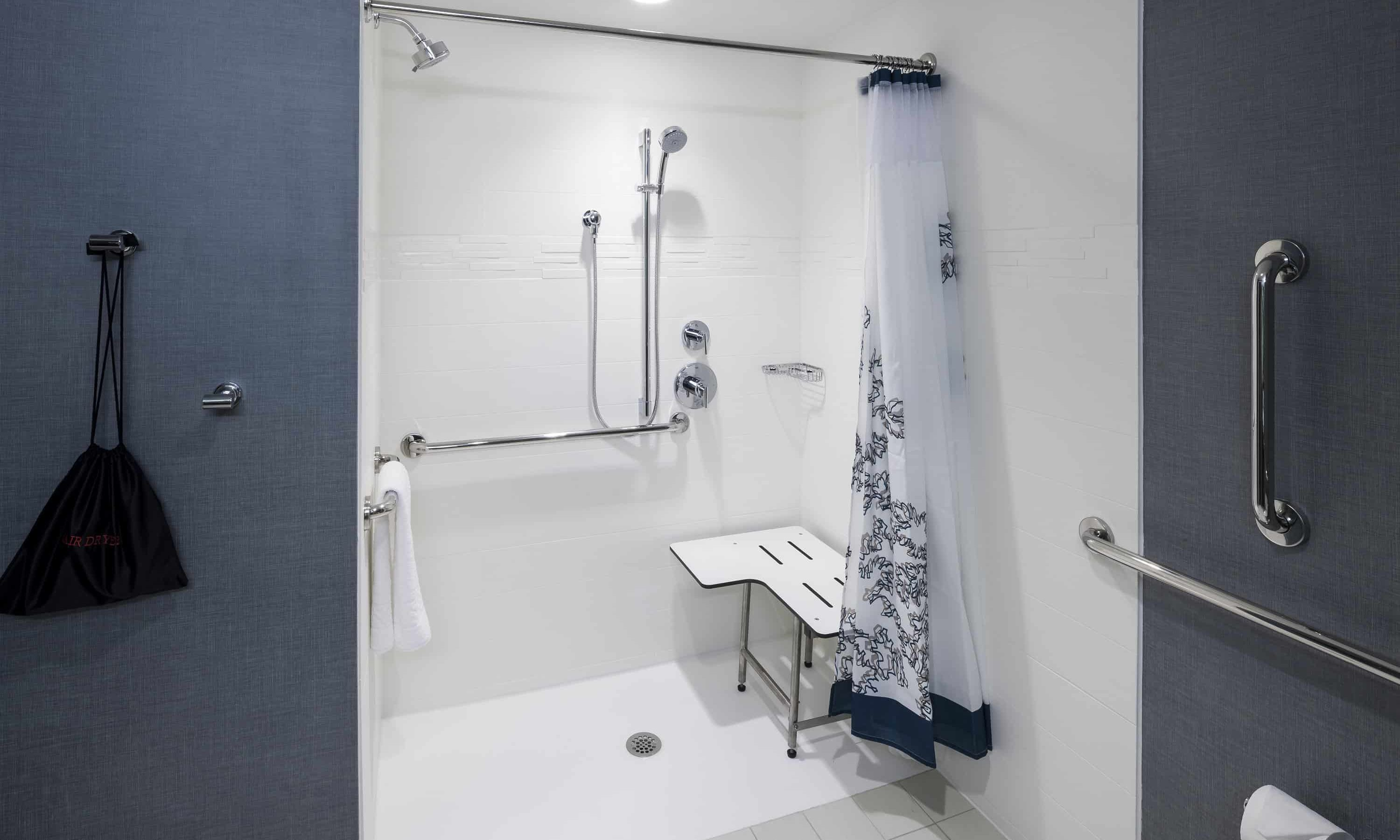 what is a roll in shower pros cons
