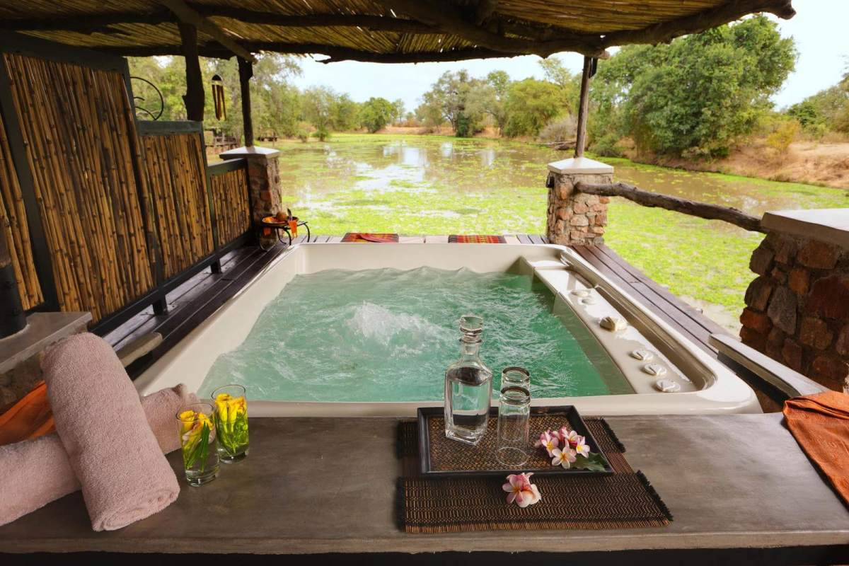 A jacuzzi with a view of the hippo-filled swamp