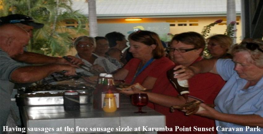 Having sausages at the free sausage sizzle at Karumba Point Sunset Caravan Park