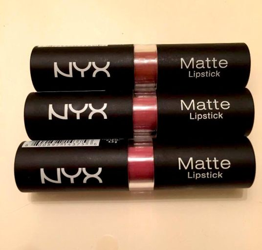 The matte black texture of the lipstick tube.