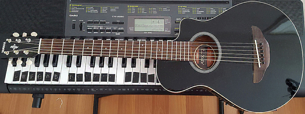 My baby guitar: 3/4 acoustic-electric Yamaha.