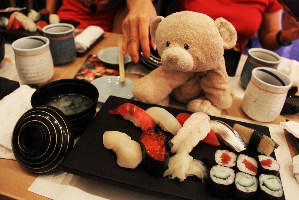 Woody enjoying delicious sushi served with miso soup.