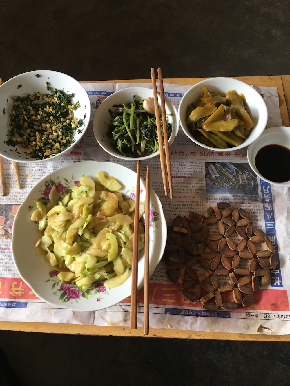 These were the side dishes that went with the porridge. Here we have tofu, string beans, pickled cucumber, and watermelon skin (Listed respectively from top left).