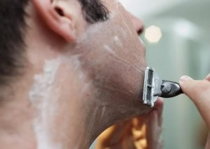 Male grooming concept of man shaving