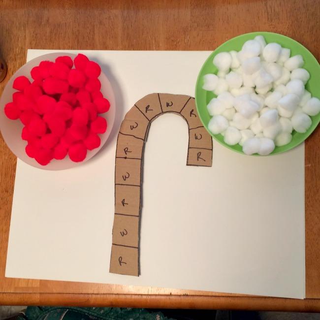 pom pom candy cane christmas craft for kids