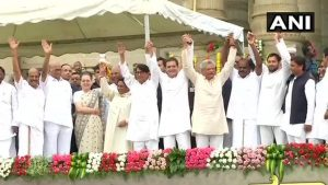 Opposition leaders pose for photojournalists in Bengaluru after Kumaraswamy was sworn in as the Chief Minister