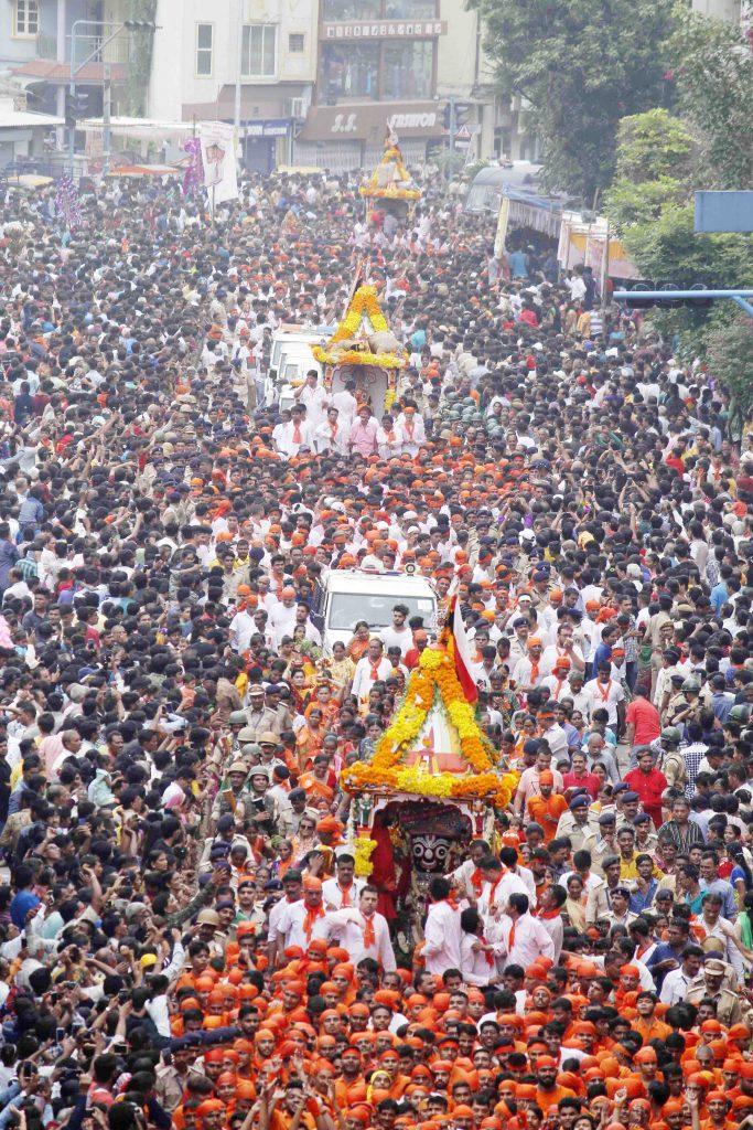 Gujarat CM Vijay Rupani and Dy CM Nitin Patel pull the chariot to mark the beginning of 141st Lord Jagannath Rath Yatra in Ahmedabad on Saturday