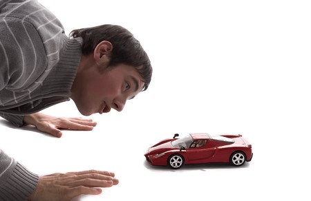 Man Looking at Small Red Sports Car 4569562_s
