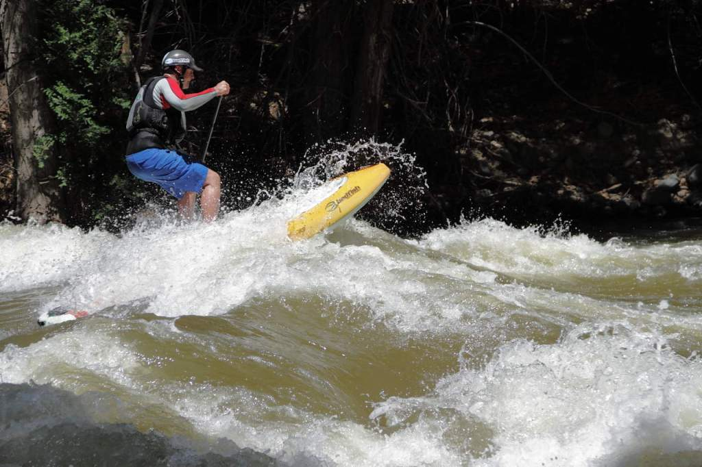 stand up paddle boarding on a river