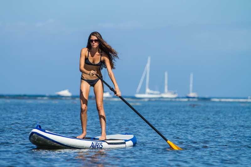 Woman riding the Airis Hard Top Board