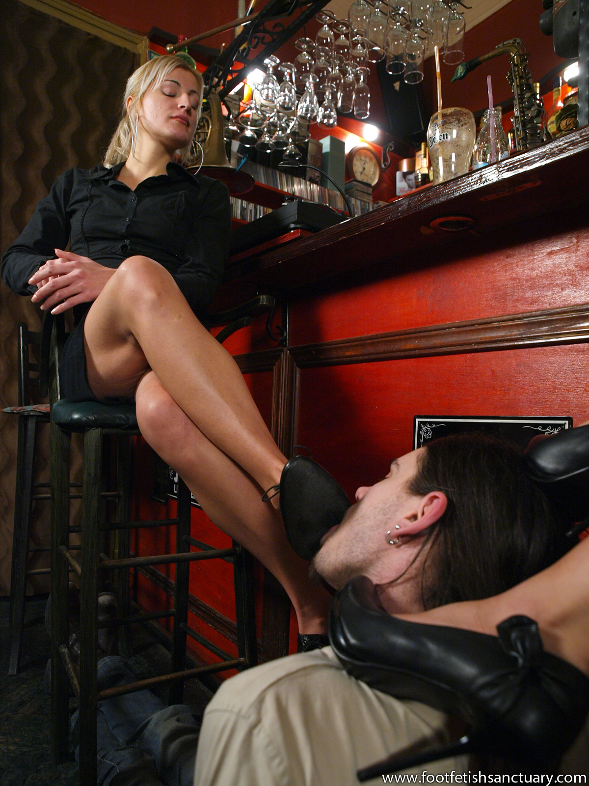 Superb Femdom  Foot Fetish Sanctuary Gallery 15  Smothering their feet over the slave in the bar