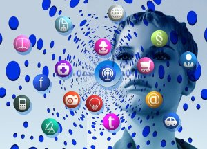 womans face surrounded by swirling social icons